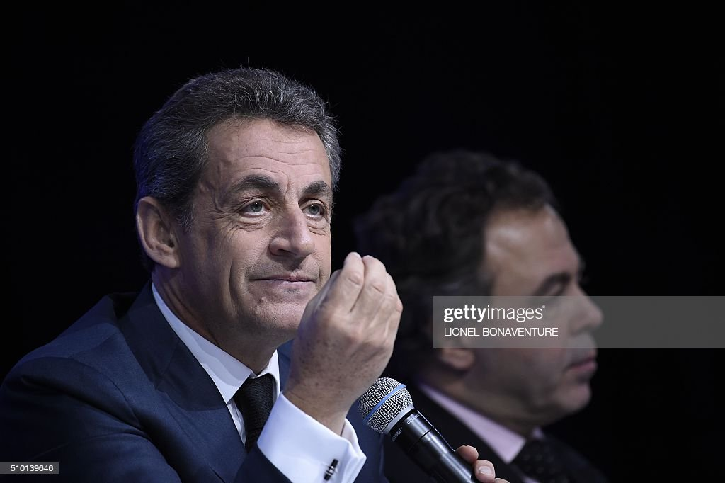 French right-wing Les Republicains (LR) party President, Nicolas Sarkozy (L) and President of the LR National Council Luc Chatel attend the LR National Council on February 14, 2016 in Paris. AFP PHOTO / LIONEL BONAVENTURE / AFP / LIONEL BONAVENTURE