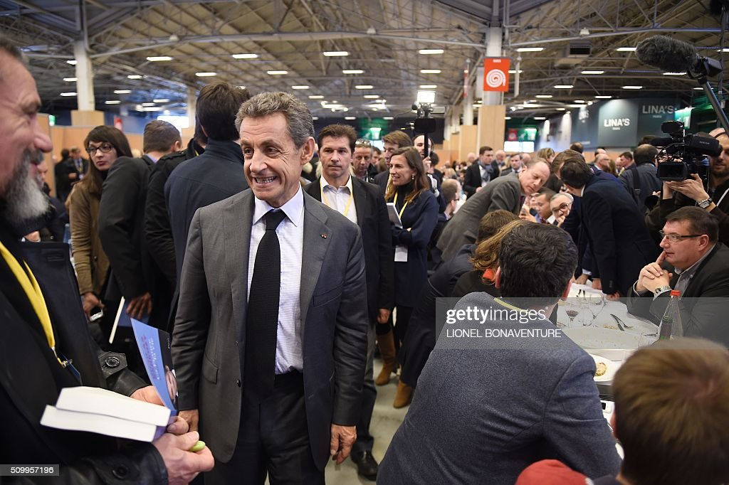 French right-wing Les Republicains (LR) party President, Nicolas Sarkozy (2nd L) attends the LR National Council on February 13, 2016 in Paris. AFP PHOTO / LIONEL BONAVENTURE / AFP / LIONEL BONAVENTURE