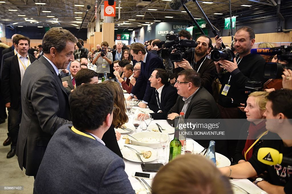 French right-wing Les Republicains (LR) party President, Nicolas Sarkozy (L) attends the LR National Council on February 13, 2016 in Paris. AFP PHOTO / LIONEL BONAVENTURE / AFP / LIONEL BONAVENTURE