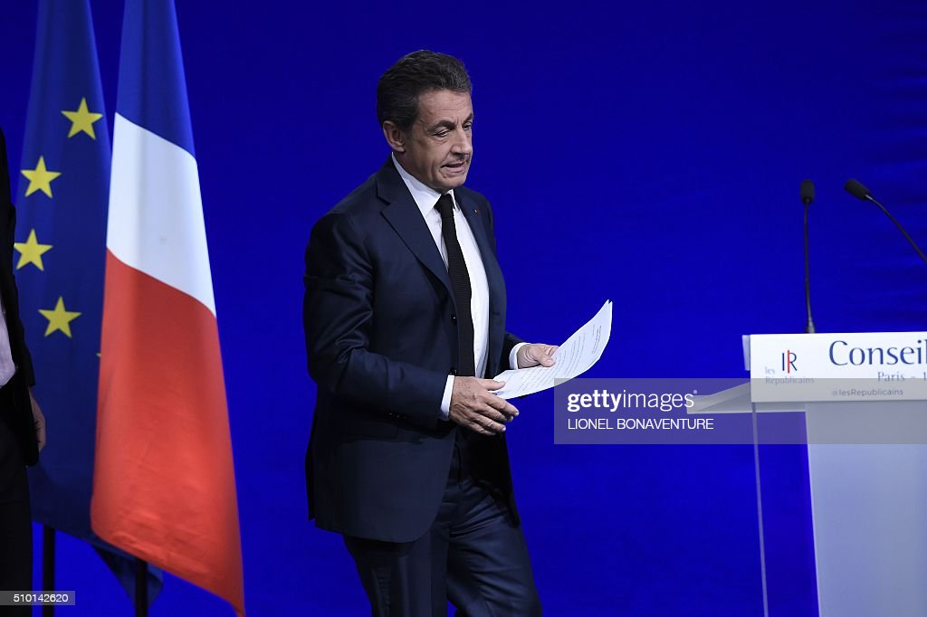 French right-wing Les Republicains (LR) party President, Nicolas Sarkozy steps onto the stage to deliver a speech during the LR National Council on February 14, 2016 in Paris. AFP PHOTO / LIONEL BONAVENTURE / AFP / LIONEL BONAVENTURE