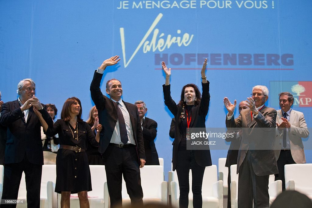 French right-wing opposition party, Union for a Popular Movement (UMP) president Jean-Francois Cope (C) waves at the audience after addressing Israelis holding the French nationality during a campaign meeting to support Valerie Hoffenberg (2ndL) UMP candidate at a local parliamentary election, on April 17, 2013 in the Mediterranean coastal city of Tel Aviv. AFP PHOTO / JACK GUEZ