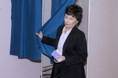 French rightwing opposition UMP party candidate Catherine Delzers leaves a polling booth prior to cast her ballot during the second round of a local...