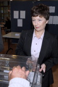 French rightwing opposition UMP party candidate Catherine Delzers casts her ballot during the second round of a local byelection on October 13 2013...