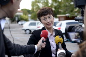 French rightwing opposition UMP party candidate Catherine Delzers speaks to journalists during the second round of a local byelection on October 13...
