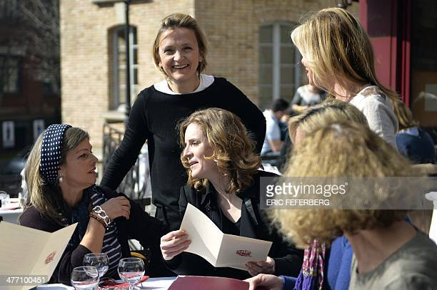French rightwing opposition UMP party candidate for the March 2014 mayoral election in Paris Nathalie KosciuskoMorizet speaks with people sitting at...