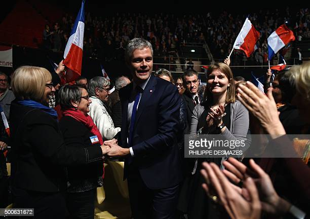French rightwing party Les Republicains chief candidate for the regional elections in the AuvergneRhoneAlpes region Laurent Wauquiez is greeted by...