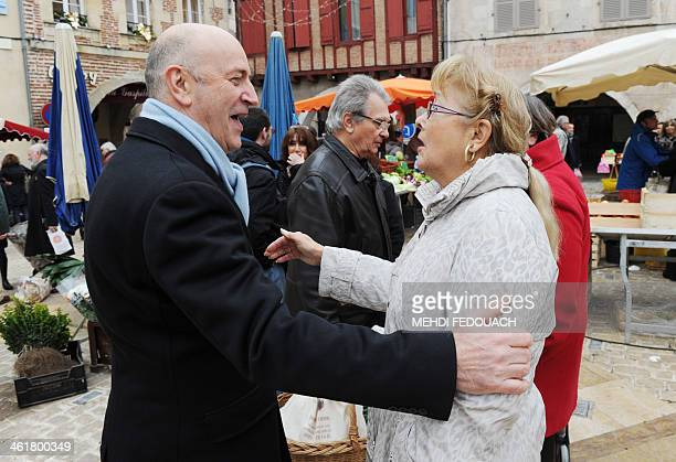 French rightwing UMP party's candidate for the 2014 mayoral election Renaud Leygue meets people on a market on January 11 2014 in VilleneuvesurLot...