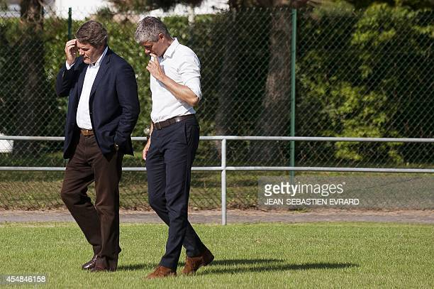 French rightwing Union for a Popular Movement member Laurent Wauquiez speaks with French political advisor Franck Louvrier as they take part in a...