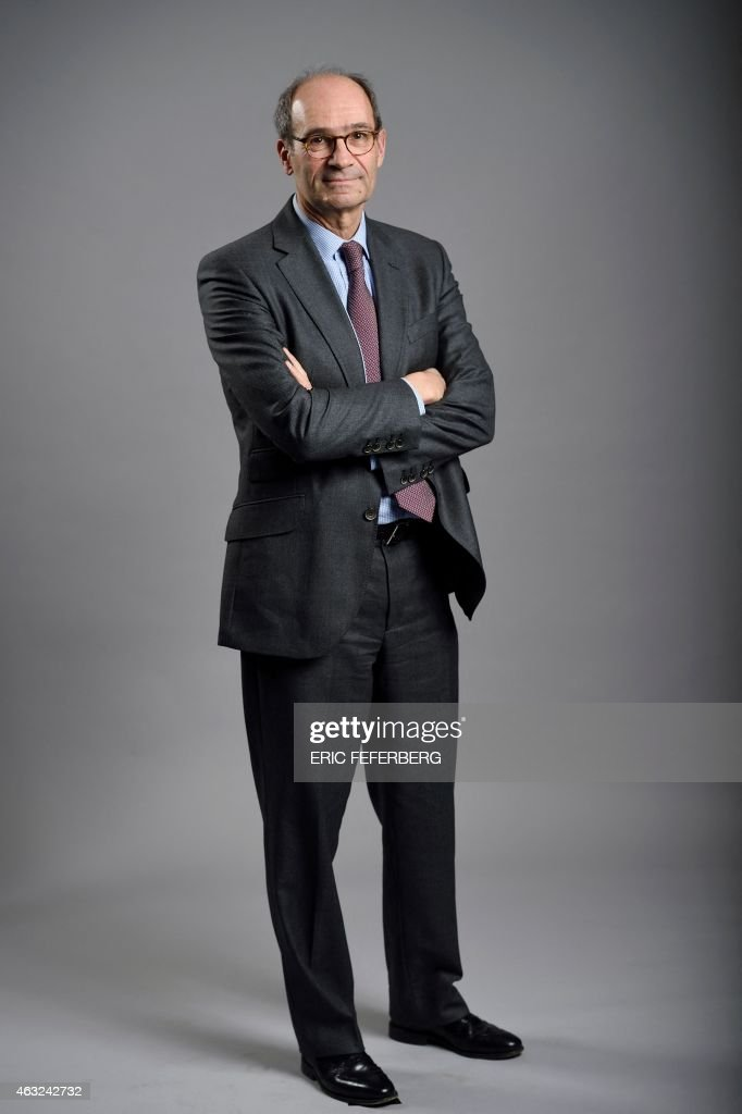 French righ-wing party UMP national delegate Eric Woerth poses on February 11, 2015 at the party headquarters in Paris.