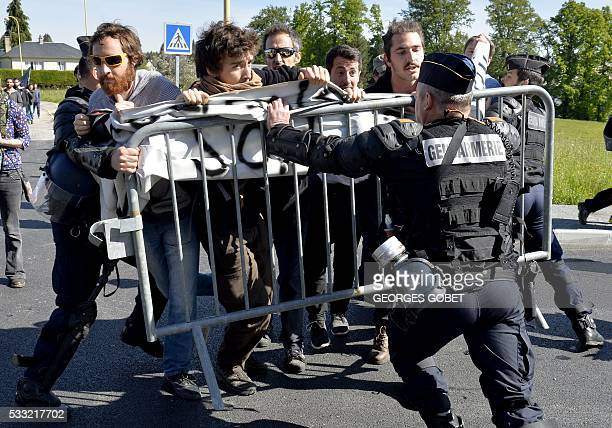 TOPSHOT French riot police clash with protesters opposed to the government's proposed labour law reforms demonstrating as French Economy and Industry...