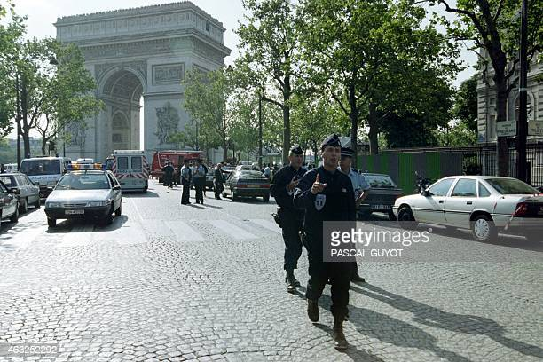 French riot police close the area around the Arc de Triomphe in Paris on August 17 1995 after a bomb packed with nails and bolts and hidden in a...