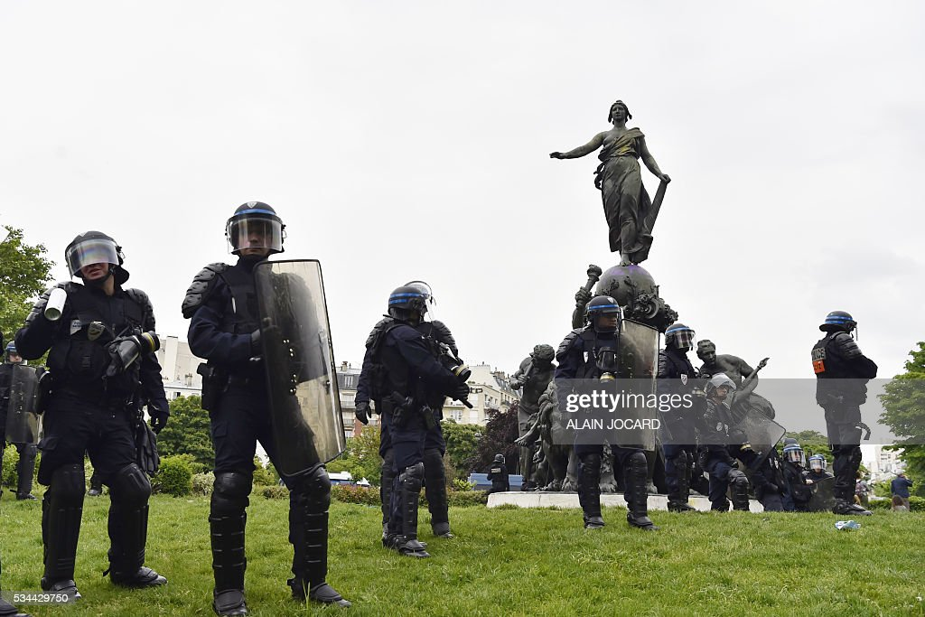 French riot police officers stand on the Place de la Nation, during a protest against the government's labour market reforms in Paris, on May 26, 2016. The French government's labour market proposals, which are designed to make it easier for companies to hire and fire, have sparked a series of nationwide protests and strikes over the past three months.