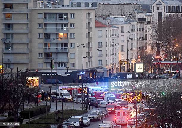 French riot policemen enter a kosher deli during a hostage situation at Port de Vincennes on January 9 2015 in Paris France According to reports at...