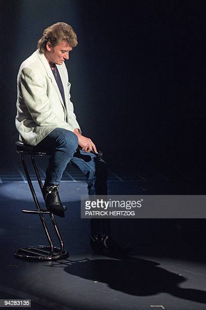 French rock singer Johnny Hallyday attends the tv show 'Sacree soiree' organized for his 46th birthday on the set of French TV channel TF1 in Paris...