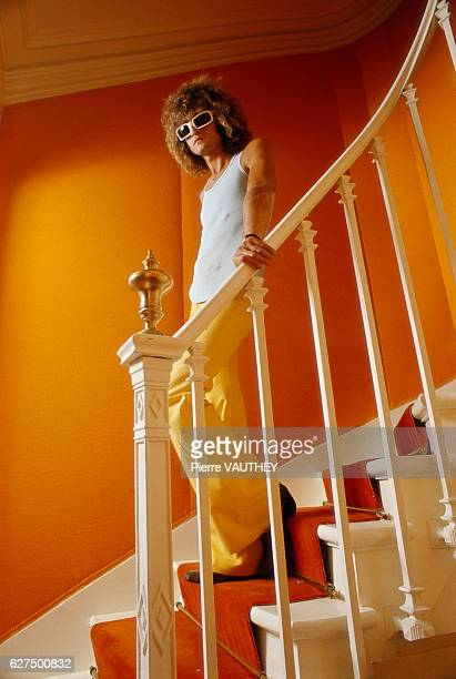 French rock singer Michel Polnareff descends a staircase in his house in Paris