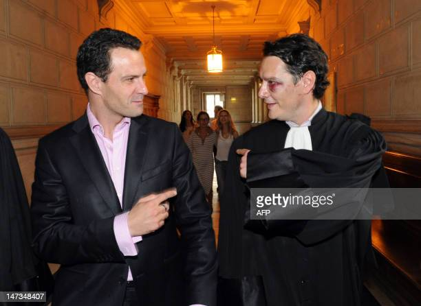 French rogue trader Jerome Kerviel arrives at the Paris courthouse on June 28 with his lawyer David Koubbi for his appeal hearing of a 2010...