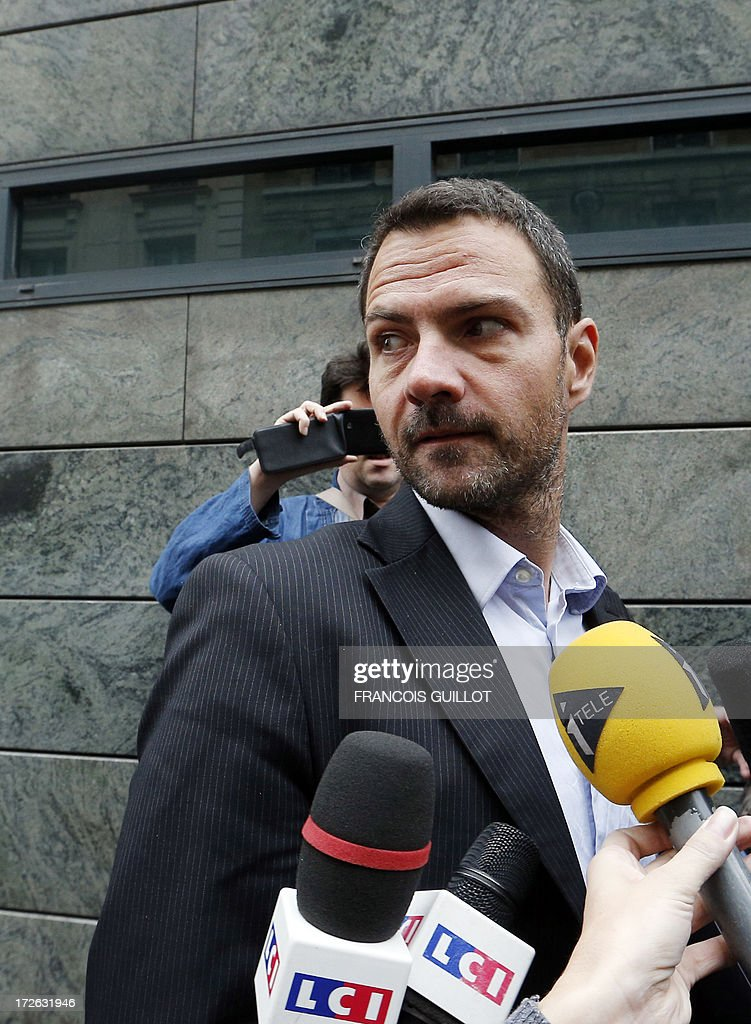 French rogue trader Jerome Kerviel (L) arrives on July 4, 2013 in Paris, at the Prudhommes court (judicial system of relations between workers and employees) flanked by his lawyer David Koubbi ( ). Kerviel lost last year his appeal against a three-year jail term and a 4.9-billion-euro fine for his part in France's biggest rogue-trading scandal. The 35-year-old was convicted of forgery and breach of trust for gambling away nearly five billion euros ($6.3-billion) in risky deals as a star trader at Societe Generale, one of Europe's biggest banks.