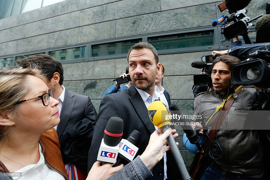 French rogue trader Jerome Kerviel arrives on July 4, 2013 in Paris, at the Prudhommes court (judicial system of relations between workers and employees) flanked by his lawyer David Koubbi ( ). Kerviel lost last year his appeal against a three-year jail term and a 4.9-billion-euro fine for his part in France's biggest rogue-trading scandal. The 35-year-old was convicted of forgery and breach of trust for gambling away nearly five billion euros ($6.3-billion) in risky deals as a star trader at Societe Generale, one of Europe's biggest banks.