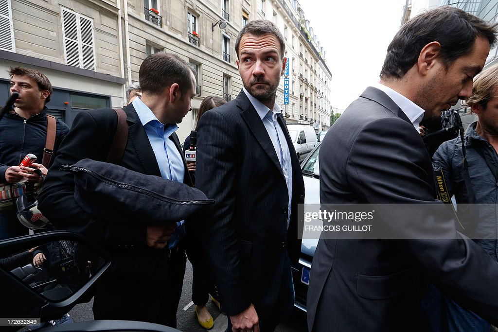 French rogue trader Jerome Kerviel (C) arrives on July 4, 2013 in Paris, with his lawyer David Koubbi (R) at the Prudhommes court (judicial system of relations between workers and employees) flanked by his lawyer David Koubbi ( ). Kerviel lost last year his appeal against a three-year jail term and a 4.9-billion-euro fine for his part in France's biggest rogue-trading scandal. The 35-year-old was convicted of forgery and breach of trust for gambling away nearly five billion euros ($6.3-billion) in risky deals as a star trader at Societe Generale, one of Europe's biggest banks. AFP PHOTO FRANCOIS GUILLOT