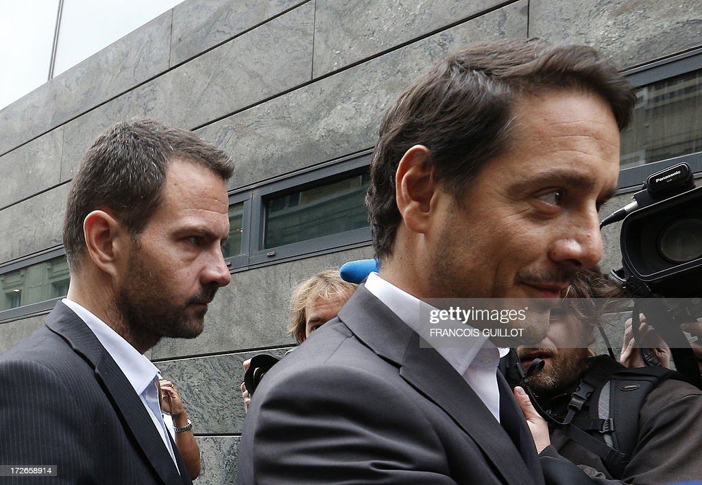 French rogue trader Jerome Kerviel (L) arrives with his lawyer David Koubbi (R), on July 4, 2013 in Paris, at the Prudhommes court (judicial system of relations between workers and employees). Kerviel lost last year his appeal against a three-year jail term and a 4.9-billion-euro fine for his part in France's biggest rogue-trading scandal. The 35-year-old was convicted of forgery and breach of trust for gambling away nearly five billion euros ($6.3-billion) in risky deals as a star trader at Societe Generale, one of Europe's biggest banks. AFP PHOTO FRANCOIS GUILLOT