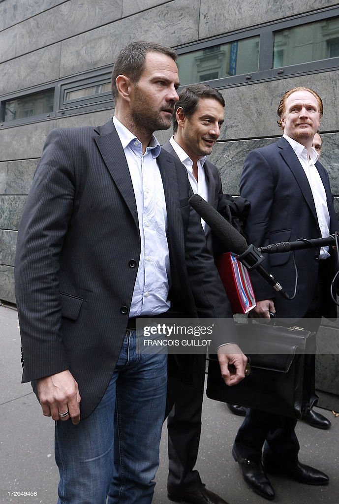 French rogue trader Jerome Kerviel (C) arrives with his lawyers David Koubbi (2ndR) and Benoit Pruvost (1stR), on July 4, 2013 in Paris, at the Prudhommes court (judicial system of relations between workers and employees). Kerviel lost last year his appeal against a three-year jail term and a 4.9-billion-euro fine for his part in France's biggest rogue-trading scandal. The 35-year-old was convicted of forgery and breach of trust for gambling away nearly five billion euros ($6.3-billion) in risky deals as a star trader at Societe Generale, one of Europe's biggest banks.