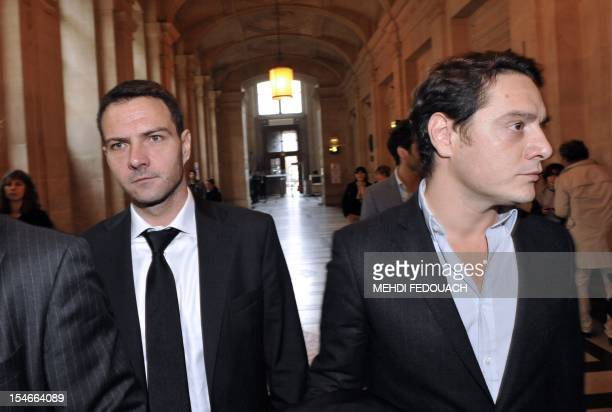 French rogue trader Jerome Kerviel flanked by his lawyer David Koubbi arrives on October 24 at the Paris court that was due to rule on his appeal for...