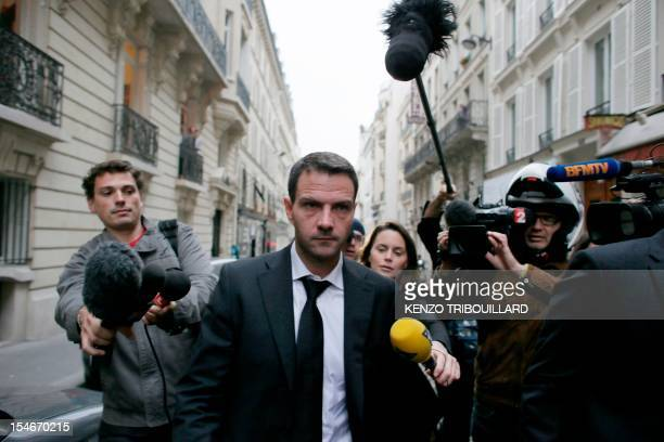 French rogue trader Jerome Kerviel leaves his lawyer's cabinet on October 24 2012 in Paris after losing his appeal against a threeyear jail term and...