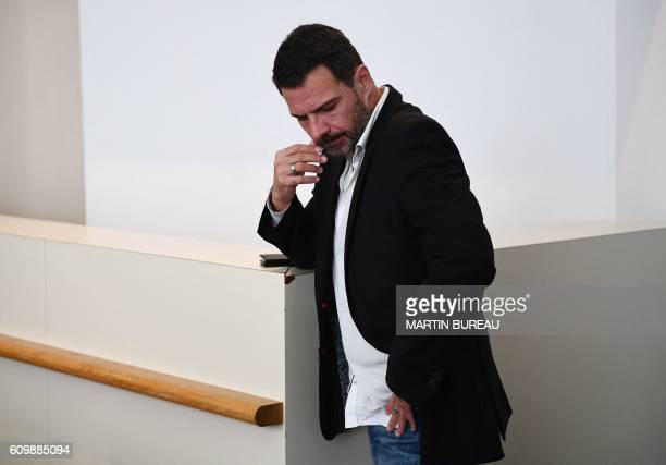 TOPSHOT French 'rogue trader' Jerome Kerviel waits before the start of his appeal trial at Versailles courthouse outside Paris on September 23 2016...