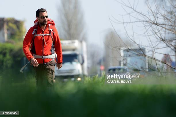 French rogue trader Jerome Kerviel walks on a road to leave Modena on March 19 during his trek from Rome to Paris 'against the tyranny of the...
