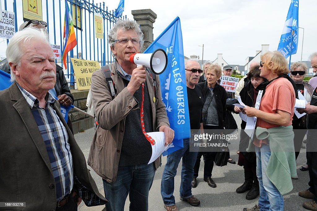 French Roland Nivet (C) in charge of the 'Peace movement' in Brittany, western France, speaks during a demonstration, on May 6, 2013, in Penmarch a day after a French test of an M51 submarine-launched ballistic missile failed as it self-destructed off the coast of Brittany. The missile was test fired, without a nuclear warhead, from the Vigilant -- a strategic nuclear submarine -- from the Bay of Audierne and had been due to go down in the isolated north Atlantic. TANNEAU