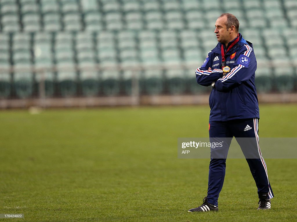 French rugby coach Philippe Saint Andre looks on during a training session in Auckland on June 13, 2013. France will play their second Test match against New Zealand's All Blacks on June 15. AFP PHOTO / MICHAEL BRADLEY