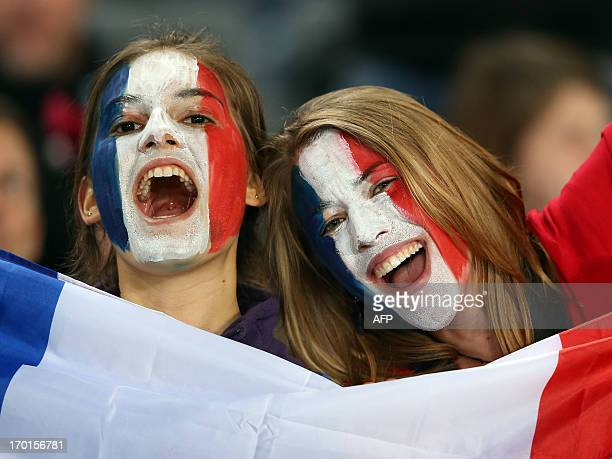 French rugby fans react during the international rugby test match between the New Zealand All Blacks and France in Auckland on June 8 2013 The All...