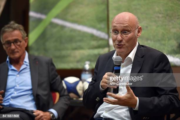 French Rugby Federation President Bernard Laporte speaks during a public debate next to French national rugby union team coach Guy Noves in La...