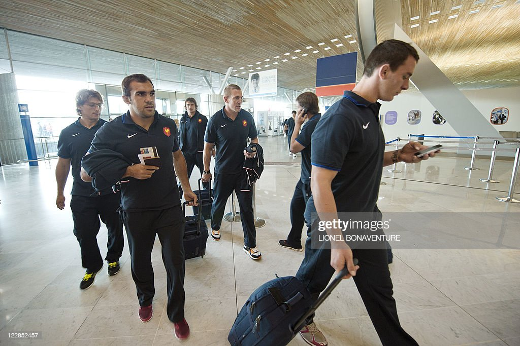 French rugby national team players arrive at the Roissy airport on August 29, 2011 in Roissy-en-France, northern suburb of Paris, before boarding an airplane to New Zealand to compete in the Rugby Union World Cup. France coach Marc Lievremont talked up his team's chances of winning the World Cup, insisting that their lengthy and intense preparations have given them real hope of lifting the Webb Ellis Trophy. AFP PHOTO / LIONEL BONAVENTURE