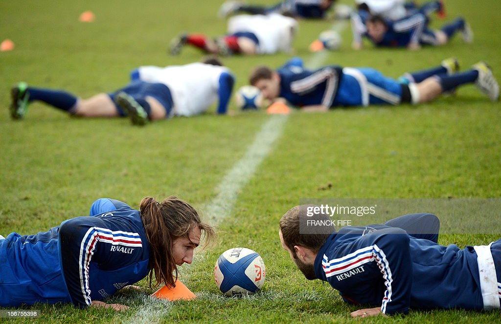 French rugby national team's back row Pierrick Gunther and scrum half Frederic Michalak take part in during a training session, on November 20, 2012 in Marcoussis, south of Paris, as part of the team's preparation for the upcoming last test match against Samoa.