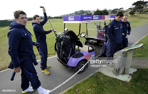 French rugby players Florian Fritz Francois TrinhDuc Yannick Jauzion and William Servat play golf at the Miramar Golf Course in Wellington on June 18...