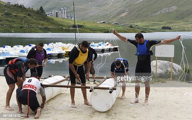 French rugby team players build rafts to take part in a contest as part of the French rugby union team's training camp in Tignes southeastern France...