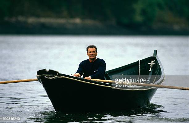 French sailor Eric Tabarly in rowboat at home