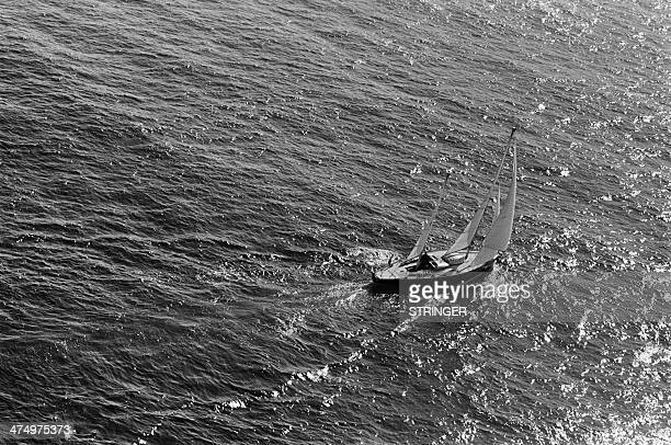 French sailor Eric Tabarly is pictured at his arrival in Newport Rhode Island on June 18 1964 as he crosses the finish line of the transatlantic race...