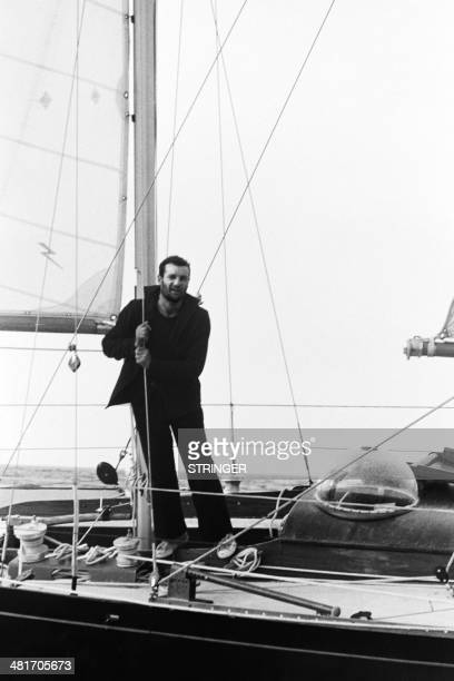 French sailor Eric Tabarly waves at his arrival in Newport Rhode Island on June 18 1964 as he crosses the finish line of the transatlantic race...