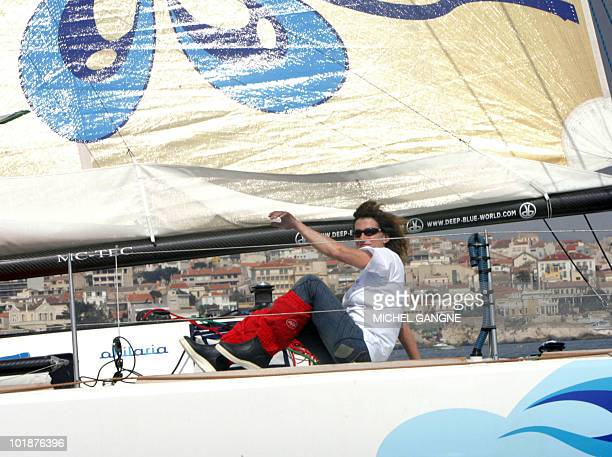French sailor Florence Arthaud is seen onboard her monohull as she take the start of the 'Route de l'Equateur' sailing race between Marseille and the...