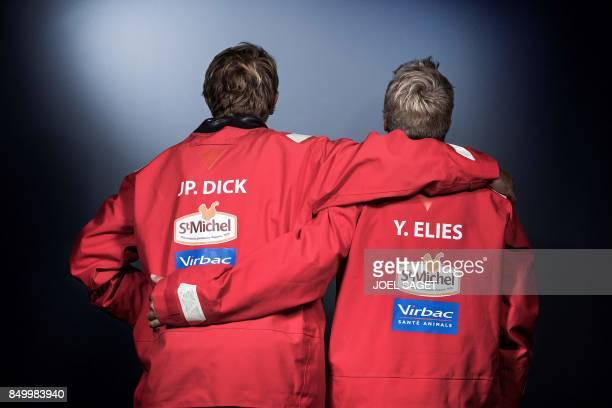 French sailor Yves Elies and JeanPierre Dick pose during a photo session in Paris on September 19 2017 / AFP PHOTO / JOEL SAGET