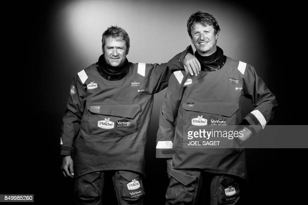 French sailor Yves Elies and JeanPierre Dick pose during a photo session in Paris on September 19 2017 / AFP PHOTO / JOEL SAGET / BLACK AND WHITE...