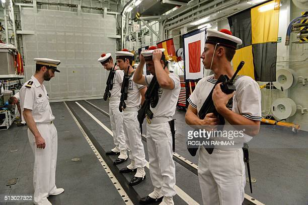French sailors prepare for the arrival of French Pacific Fleet commander rearadmiral BernardAntoine Morio de lIsle onboard the French Navy...
