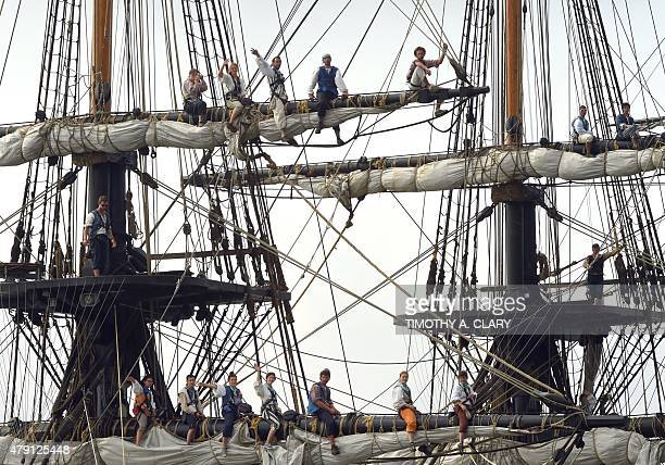 French sailors sit in the rigging aboard a replica of the frigate Hermione that ferried the Marquis de Lafayette to America during the Revolutionary...