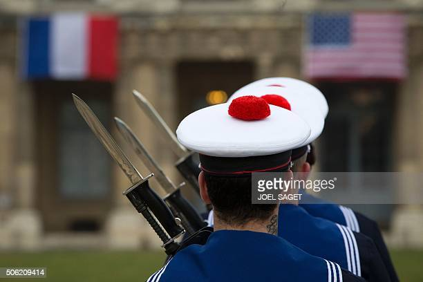 French sailors stands to attention as they wait for the arrival of US Marine Corps General Joseph Dunford and French Army Chief of Staff General...