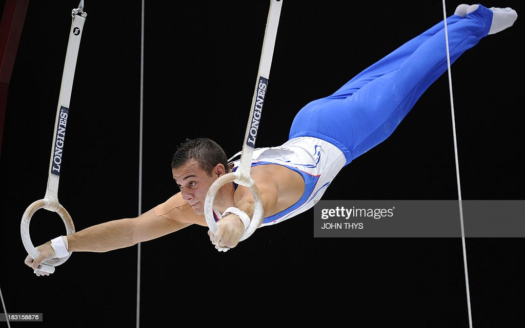 French Samir Ait Said performs during the men's rings final at the 44th Artistic Gymnastics World Championships in Antwerp on October 5, 2013. AFP PHOTO/JOHN THYS