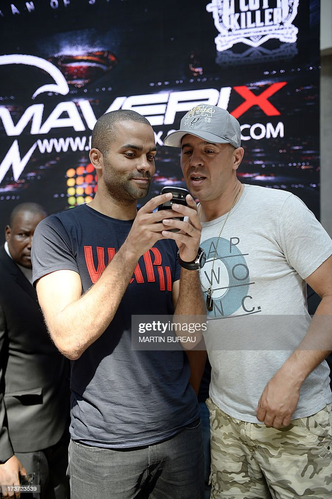 French San Antonio Spurs basketball player Tony Parker (L) and French DJ Cut Killer (R) pose during a photocall, on June 17, 2013 in La Defense, near Paris.