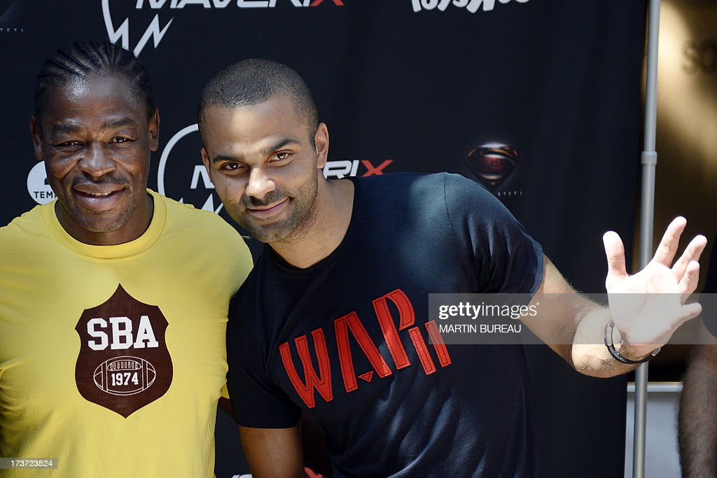 French San Antonio Spurs basketball player Tony Parker (R) and French rugby player Serge Betsen (L) pose during a photocall, on June 17, 2013 in La Defense, near Paris.