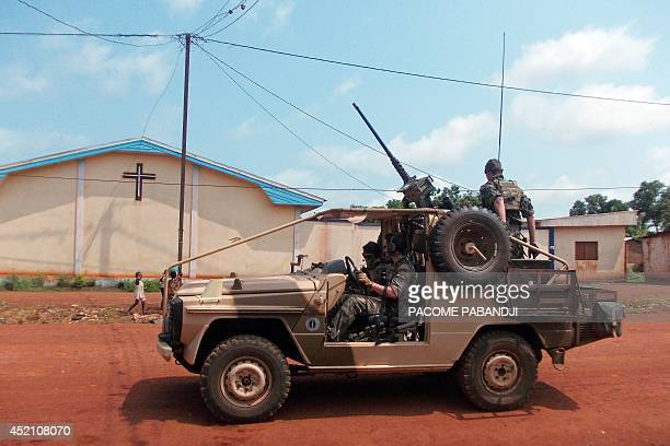 French Sangaris troops patrol in a jeep near a church in Bangui the Central African capital on July 13 2014 The former president of wartorn Central...